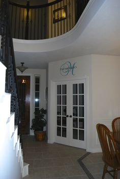 Monogram over our music room doors. It's more teal than light blue, as it appears in the photo.