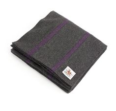 The Merchant Fox: College style scarf made from Fox Brothers' 'West of England' lightweight flannel in charcoal grey with an aubergine stripe .This lighter weight 300g worsted pure new wool cloth is woven at the Fox Brothers and Co. mill.