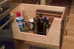 """A """"Chef Drawer"""" is a deep drawer with a u-shaped cutout for visibility, kept next to the stove for tall cooking oils and sauces. Love it!"""