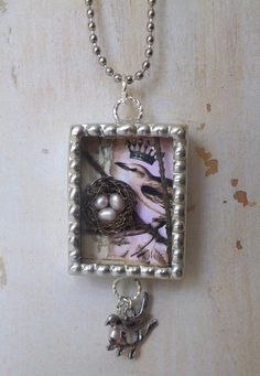 Soldered Shadowbox Pendant Necklace with 3-D Birdnest and Original Collaged Images by Maggie Raguse. $42.00, via Etsy.