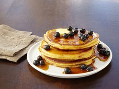 Get this all-star, easy-to-follow Food Network Buttermilk Pancakes With Vanilla Bean-Berry Syrup recipe from Patrick and Gina Neely.