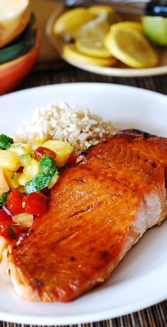 Broiled salmon with mango salsa and rice. Refreshing like a salad, full of antioxidants, fiber, fruit, proteins, and omega-3! Easy to make! | JuliasAlbum.com | #seafood #healthy #fish