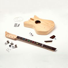 Teach your kids to be luthiers early! (Loog Guitars)
