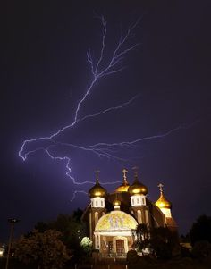 Lightning spreads across the sky over the Russian Orthodox Church of Three Saints in Garfield, N.J...amazing shot!