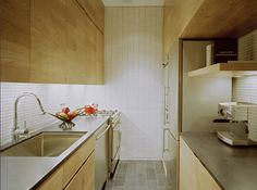 Imagine taking a 500 square foot apartment with only one window and make it liveable. Kitchen