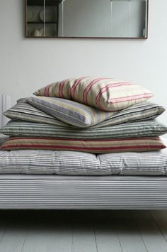 Cotton ticking bed sheets.