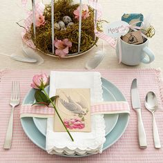 Stylish Easter Place Setting    In place of traditional bunnies, try a stylish bird theme for your Easter table. Light blue plates complement pink gingham place mats; break up the color palate with lacy-edge white napkins. A nest of dried moss inside a birdcage becomes an easy centerpiece -- accent it with pink blossoms (in florist's water picks) and pink gingham ribbon to match the place setting.