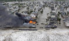 Hurricane Ike BEFORE the storm surge.  The surge before the storm swamps Galveston Island, Texas, and a fire destroys homes along the beach as Hurricane Ike approaches Friday, Sept. 12, 2008. (AP Photo/David J. Phillip) This is the before shot.