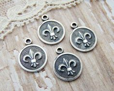 Chic Antiqued Silver Ox Fleur de Lis by alyssabethsvintage on Etsy, $3.99
