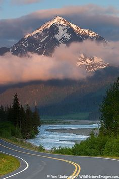 Herman Leier Road also known as Exit Glacier Road runs along the Resurrection River with Mount Benson in the background,  Chugach National Forest, near Seward, Alaska