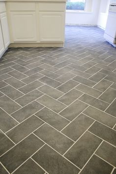 Herringbone porcelain tiles for the floor - maybe with darker grout