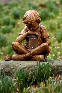 Garden statue - Boy with fireflies / the fireflies are solar powered.