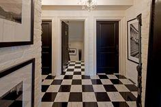 white walls/trim with black doors
