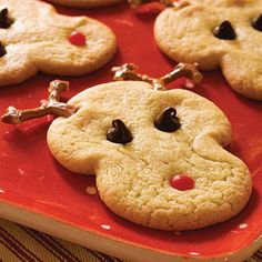 Rudolph's Christmas Sugar Cookies | Start with refrigerated sugar cookie dough to make these adorable reindeer cookies. Kids can help place Rudolph's eyes, mouth, and antlers. | SouthernLiving.com
