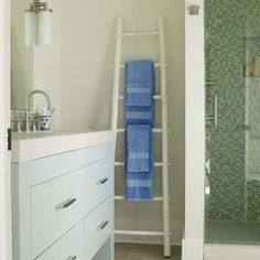 Lean a ladder against a wall and sling bath sheets and washcloths over its rungs for a stylish bath-towel rack. | Photo: David Prince | thisoldhouse.com