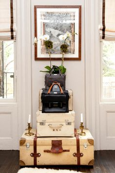 a stack of vintage suitcases.
