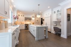 white kitchen & light gray island finish   SIR Development