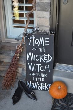 Cute sign for the front door with a witch broom and pointy shoes