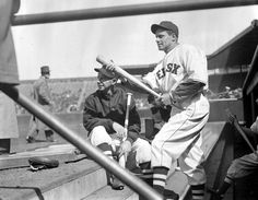 (l to r:) Boston Red Sox catcher Rick Ferrell and Boston Red Sox pitcher Wes Ferrell holding bats on the dugout steps at Fenway Park around 1935.