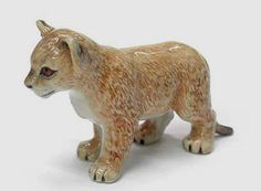 Porcelain lion cub