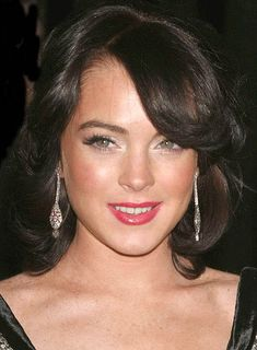 Lindsay Lohan. She is so pretty here, taking this color to hair salon tomorrow.