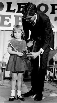 Julie Dick, 5, receives the Billboard award for her late mother, Patsy Cline, at the opening breakfast of the 12th annual Country Music Festival at the Municipal Auditorium, Nov. 1, 1963.