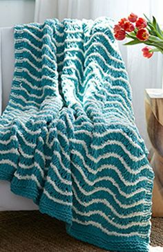 Crochet the perfect blanket for fall! Stay warm and cuddly with this DIY project.