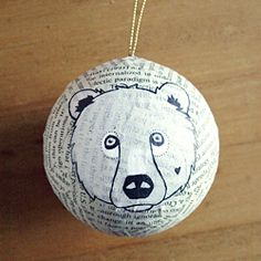 DIY illustrated Christmas ornaments with papier-maché, paint and a pen.
