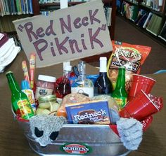 "Redneck Picnic Basket - Silent Auction ideas - includes Camo and Blaze Orange Toilet Paper, Red Solo Cup Wine Glasses, Moonshine, Slim Jims, Pickled Eggs, Pork Rinds, Redneck Party Music CD, Racoon ""Roadkill"" Dog Toy, Boones Farm Wine, Easy Cheese, and Pickled Pigs Feet"