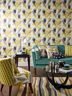 family room... paper in the back of the built ins with light grey walls.  Then accents of yellow and teal.  FUN!