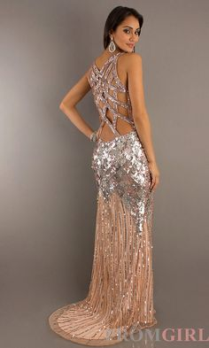 A sexy long sequin evening dress featuring a low cut V-neckline and sensational detailing across the seductive open back. A sexy side slit on the floor length skirt adds the perfect finishing touch to this sparkling gown.
