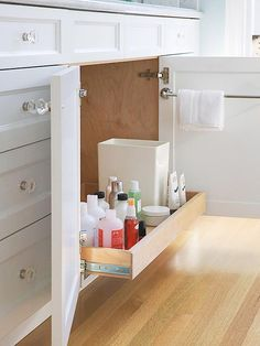 Easily access bath essentials with this convenient pullout shelf. More storage-packed baths: http://www.bhg.com/bathroom/storage/storage-solutions/ultimate-storage-packed-bathrooms/?socsrc=bhgpin072613pulloutshelf=20