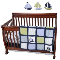 Dress your baby boys nursery in classic rich color with this Zachary Crib Bedding Set from Nautica Kids! Sailboat appliques crafted from different prints and colors adorn the quilt and wall art