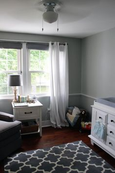 Relaxing nursery with gray and whites