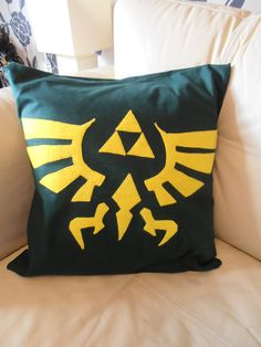 The Legend of Zelda Crest Pillow by GeekyCatUK on Etsy, £25.00