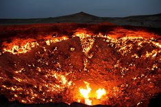 'The Door to Hell', Derweze, Turkmenistan by wikipedia: While drilling in 1971, Soviet geologists tapped into a cavern filled with natural gas. The ground beneath the drilling rig collapsed, leaving a large hole with a diameter of 70  To avoid poisonous gas discharge, it was decided to burn it off. Geologists had hoped the fire would use all the fuel in a matter of days, but the gas is still burning today. Photo by flydime. #Door_to_Hell #Derweze #wikipedia