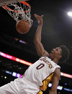 Los Angeles Lakers forward Nick Young (0) dunks against the Denver Nuggets during the first half of an NBA basketball game Sunday, Jan. 5, 2014, in Los Angeles. (AP Photo/Alex Gallardo)
