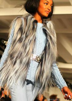 Jourdan Dunn in Faux vest w/powder blue knit and trousers
