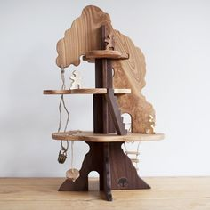 Can I just play with these toys?!  I think I might need to have one of my own, lol.  Wooden Fairy Tree House.  So cool.