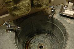 cool rustic sink in B cabin in New Braunfels
