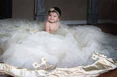 baby girl in mommy's wedding dress
