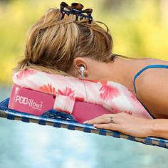 Tanning pillow -- has compartments for ipod/cell phone and a hole cut for your face.