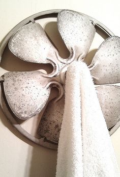 take an old fan and attach a glass knob to the middle and make a towel holder, love it.....