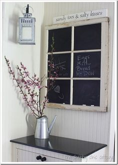 use chalkboard paint on the panes of an old window...great idea