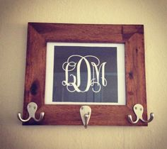 "Used a free printable monogram (can be found on my ""Craft Ideas"" board), drunk octopus hooks and a picture frame. DIY key hook :) great for bottle cap jewelry, glass tile jewelry & fridge magnets too! #ecrafty"
