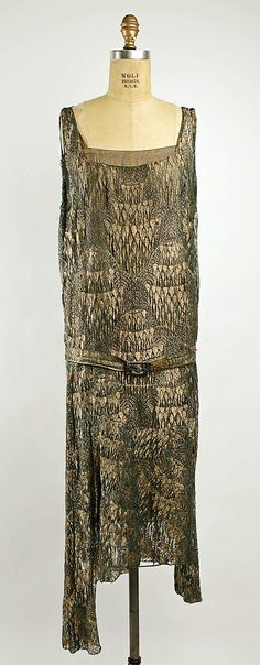 a dress of gold and glass. circa 1925.  cotton, gold, glass.