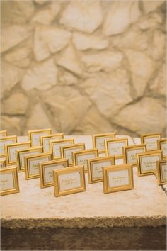 gold framed escort cards #diy #escortcards #weddingchicks http://www.weddingchicks.com/2014/02/21/classic-pink-and-gold-wedding/