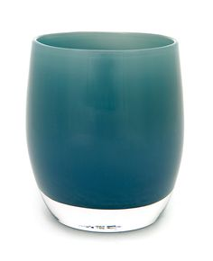 luxury is a teal handmade glass candle holder or vase.