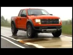 Red Ford Raptor SVT Truck in the rain