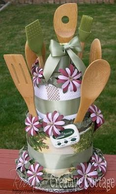 towel cake for a bridal shower or housewarming gift ~ diy ~ kitchen towels, oven mitt, dish rag, utensils, timer ~ instructions